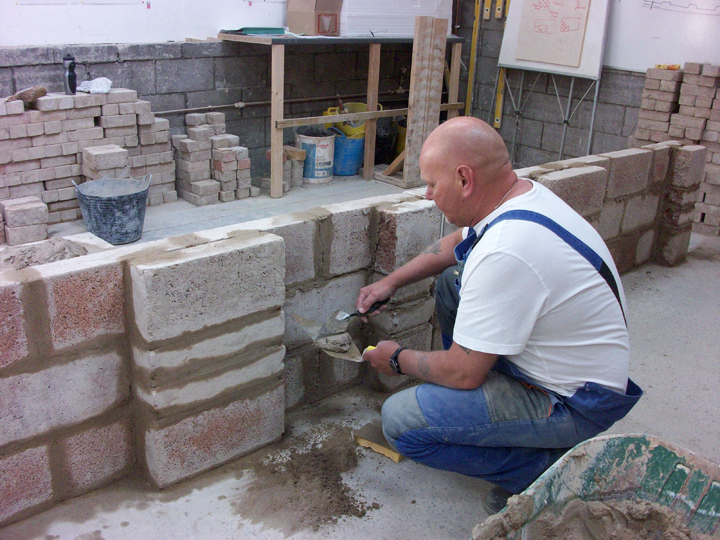 An image of a person bricklaying