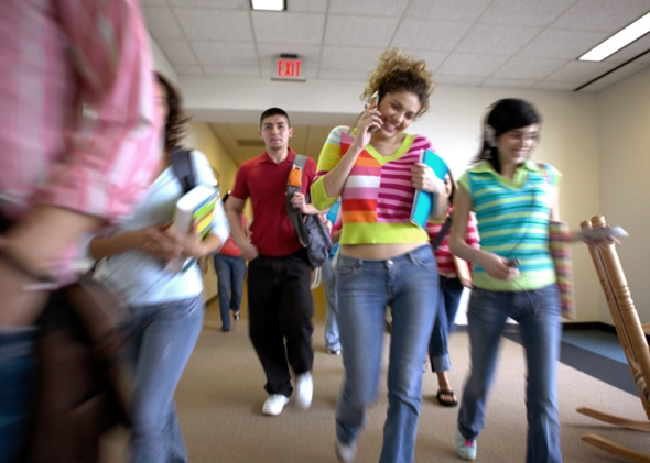 An image of students walking down a school corridor