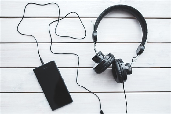 An image of a music player and earphones